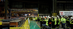 © Licensed to London News Pictures. 18/04/2012..SSI Steel, Teesside, England..Workers look on as the first slab of steel is produced at the SSI UK steel works on Teesside..Two years after the closure of the Corus steel production plant, the huge blast furnace on the site in Teesside was re-lit at the weekend as the process of bringing the furnace back to operating temperature begins...Today, the furnace, now owned by the Thai company Sahaviriya Steel Industries saw the first steel slabs come out of the furnace. ..The steel will now be shipped direct to SSI in Thailand for use in the car or white good industries...Photo credit : Ian Forsyth/LNP