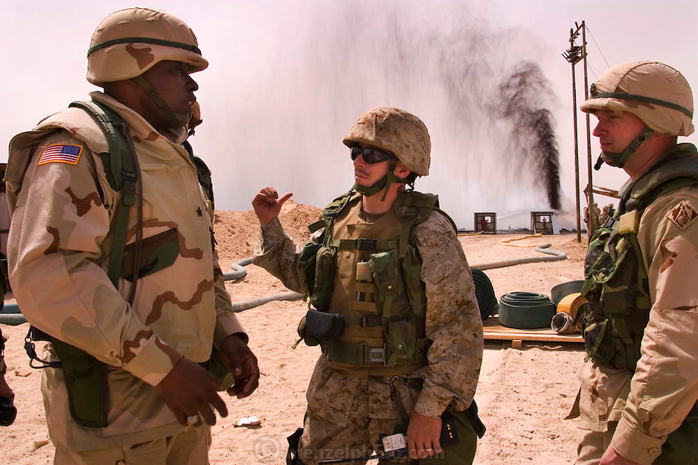 General Crear of the Army Corps of Engineers talks with soldiers who have come to gawk and give a press tour of one of the burning oil wells just extinguished by Boots and Coots in Iraq's Rumaila Oil Field. The Rumaila field is one of Iraq's biggest oil fields with five billion barrels in reserve. Rumaila, Iraq. Rumaila is also spelled Rumeilah.