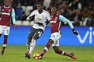 Angelo Ogbonna Obinze of West Ham United is challenged by Paul Pogba of Manchester United. Premier league match, West Ham Utd v Manchester Utd at the London Stadium, Queen Elizabeth Olympic Park in London on Monday 2nd January 2017.<br /> pic by John Patrick Fletcher, Andrew Orchard sports photography.