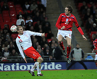 Photo: Tony Oudot/Richard Lane Photography. <br /> England v Switzerland. International Friendly. 06/02/2008. <br /> Peter Crouch of England challenges Stephane Grichting of Switzerland to the ball