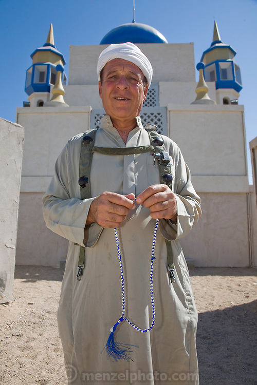 An actor dressed as an Iraqi man stands outside a mosque in the fabricated Iraqi village of Medina Wasl at Camp Irwin, California, in the Mojave Desert. The village is used for training soldiers deploying to Iraq.
