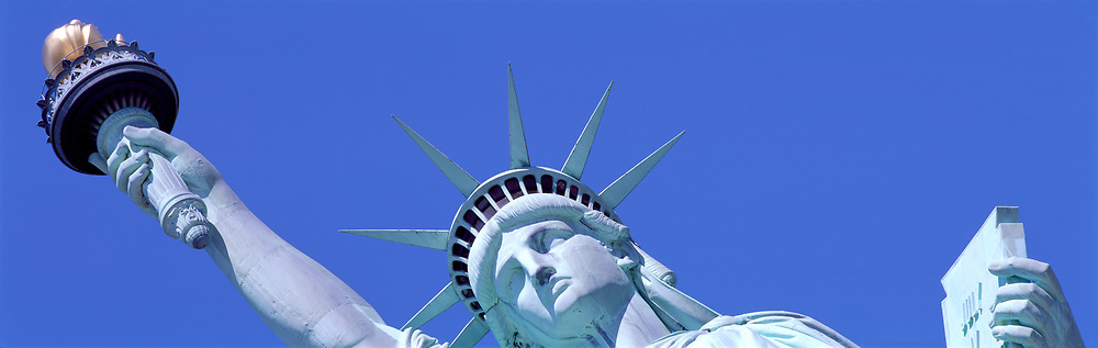 Statue of Liberty detail looking up with blue sky