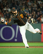 San Francisco Giants shortstop Brandon Crawford (35) chases down a Oakland Athletics ground ball with his bare hand at AT&T Park in San Francisco, California, on March 30, 2017. (Stan Olszewski/Special to S.F. Examiner)
