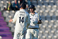 Gary Ballance of Yorkshire walks off at the end of play on day 1 unbeaten on 120 not out and is congratulated by James Vince of Hampshire during the Specsavers County Champ Div 1 match between Hampshire County Cricket Club and Yorkshire County Cricket Club at the Ageas Bowl, Southampton, United Kingdom on 11 April 2019.