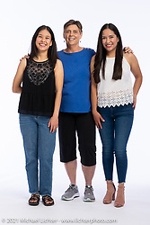 Yoli Chavez (L) with her sister Alma (R) and Vicki Kinzie at the Intercambio portrait Shoot. Longmont, CO, USA. June 5, 2021. Photography ©2021 Michael Lichter. Usage rights granted to Intercambio Uniting Communities and its assigns.
