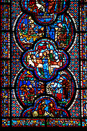 Medieval stained glass Window of the Gothic Cathedral of Chartres, France - dedicated to St John The Evangelist. Bottom panel - Flight into Egypt . Above left - Armourers making shields and saddles, above right - Armourers making stirrups. Central panel - Death of Satheus, above left - John's journey into exile on Patmos, above right - St John on Patmos. A UNESCO World Heritage Site.. .<br /> <br /> Visit our MEDIEVAL ART PHOTO COLLECTIONS for more   photos  to download or buy as prints https://funkystock.photoshelter.com/gallery-collection/Medieval-Middle-Ages-Art-Artefacts-Antiquities-Pictures-Images-of/C0000YpKXiAHnG2k