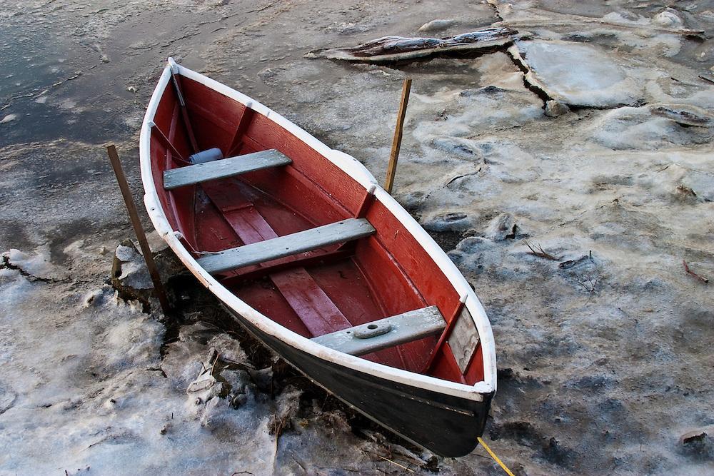Red dinghy frozen in Comox harbour, Comox BC