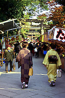 """Ladies in kimono at Kitano Tenmangu Shrine Market - On the 25th of every month, the shrine hosts a flea market. Together with the similar market at Toji Temple, they inspired the Kyoto proverb, """"Fair weather at Toji Market means rainy weather at Tenjin market,"""" referring to Kyoto's fickle weather."""