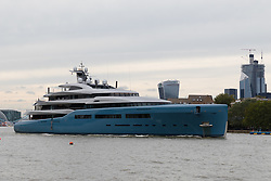 © Licensed to London News Pictures. 12/09/2018. London, UK.  Billionaire Spurs owner, Joe Lewis's 321 feet long luxury superyacht Aviva leaves London on the River Thames passing skyscrapers following a London visit. Aviva, worth an estimated £113m is one of a growing number of superyachts to visit the capital this year and moored near Butlers Wharf for a number of weeks, during which wealthy homeowners criticised the Spurs owner for spoiling their river view.  Photo credit: Vickie Flores/LNP