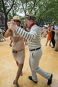 A member of the Dreamland Orchestra and his partner dance a tango.