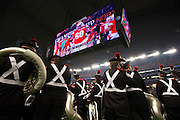 The Ohio State Buckeyes marching band lines up before their halftime performance during the College Football Playoff National Championship Game at AT&T Stadium on January 12, 2015 in Arlington, Texas.  (Cooper Neill for The New York Times)