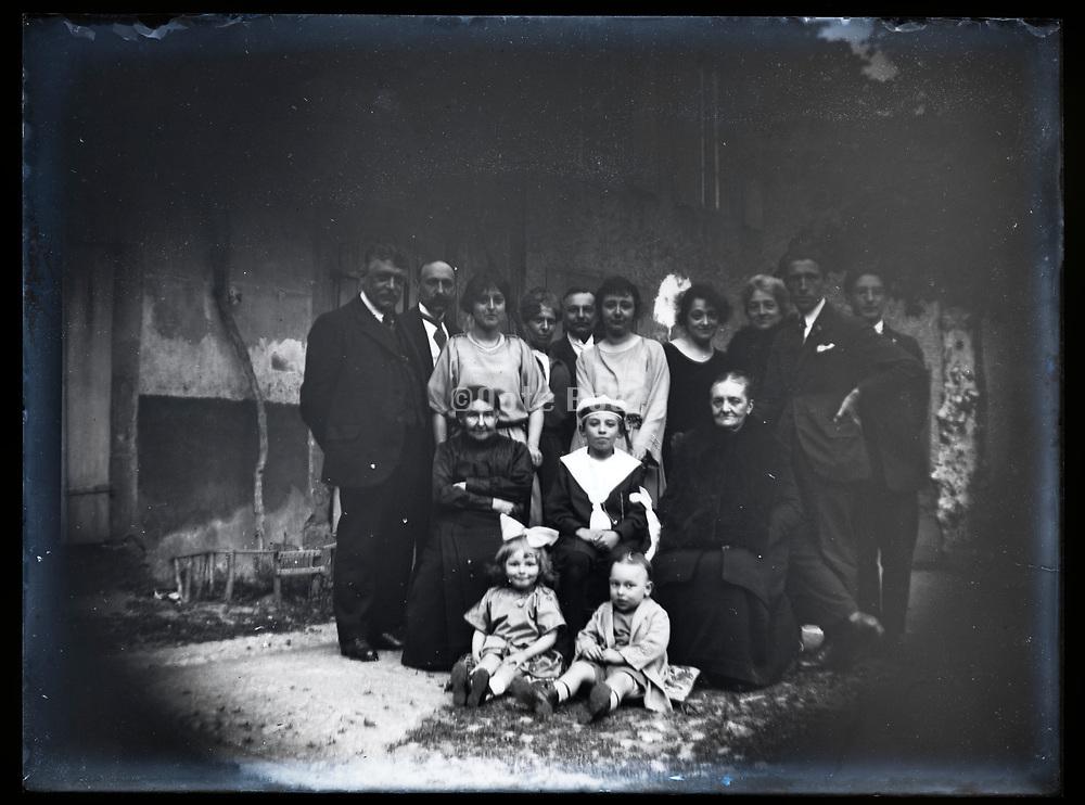 family group portrait celebrating boy communication France 1923