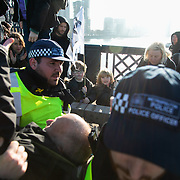 Thousands of Extinction Rebellion activists took over 5 bridges in Central London and blocked them for the day, November 17 2018, Central London, United Kingdom. Lambeth Bridge; an elderly quaker man is arrested and taken away by police. Around 11am people on all bridges sat down in the road and blocked traffic from coming through and stayed till late afternoon. The actvists believe that the government is not doing enough to avoid catastrophic climate change and they demand the government take radical action to save future generations and the planet. Many are willing to be arrested peacefully protesting and up to 80 were arrested on the day.Extinction Rebellion is a grass root climate change group started in 2018 and has gained a huge following of people commited to peaceful protests and who ready to be arrested. Their major concern is that the world is facing catastropohic climate change and they want the British government to act now to save future generations.