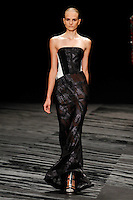 A model walks the runway wearing J. Mendel Spring 2015 during Mecedes-Benz Fashion Week in New York on September 10th, 2014