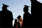 Breann Carpenter [cq] (middle), along with her fellow graduates, wait patiently before the start of the 48th annual commencement exercise held at Jackson Memorial High School on June 24, 2014.