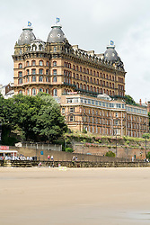 Scarborough Grand Hotel is a Grade II listed building Dominating the the town's South Bay. When completed in 1867 it was one of the largest hotels in the world, as well as one of the first giant purpose-built hotels in Europe. The hotel is in the shape of a 'V' in honour of Queen Victoria and was designed around the theme of time: <br /> 4 towers to represent the seasons, <br /> 12 floors for the months of the year, <br /> 52 chimneys symbolise the weeks, <br /> originally there were 365 bedrooms - one for each day of the year. <br /> As Scarborough was a famous 'Spa Town' in its heyday the Grand hotels baths included an extra pair of taps so guests could wash in seawater as well as fresh water.<br /> The hotel was badly damaged when the German Navy bombarded the town in 1914.<br /> Three blue plaques outside mark where the novelist Anne Brontë died in 1849, the contribution of the RAF trainees stationed at the hotel during the Second World War, and the original opening of the building.<br />  11 July 2016<br />  Copyright Paul David Drabble<br />  www.pauldaviddrabble.photoshelter.comom