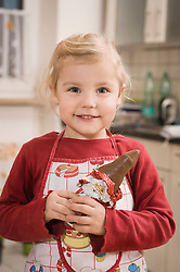 Girl eating chocolate, smiling, portrait