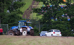 Car being towed out the car park, Monday after the T in the Park 2016 weekend, Strathallan Castle, Perthshire.