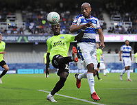 Football - 2018 / 2019 EFL Carabao Cup (League) Cup - Queens Park Rangers vs. Peterborough United<br /> <br /> Siriki Dembele of Peterborough and Alex Baptiste of QPR, at Loftus Road.<br /> <br /> COLORSPORT/ANDREW COWIE