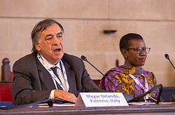 © Licensed to London News Pictures. 22/10/2018. Bristol, UK. Global Parliament of Mayors Annual Summit, 21-23 October 2018, at Bristol City Hall. Picture of LEOLUCA ORLANDO, Mayor of Palermo, Italy, taking part in the plenary session on harnessing the power of migration, with YVONNE AKI-SAWYERR, mayor of Freetown, Sierra Leone. The Global Parliament of Mayors 2018 is the biggest and most ambitious Annual Summit to date. GPM Bristol 2018 will host up to 100 global mayors for an action-focused summit that addresses some of the biggest challenges facing today's world cities. GPM Bristol 2018's theme, Empowering Cities as Drivers of Change, will focus minds on global governance and the urgent need for the influence, expertise and leadership of cities to be felt as international policy is shaped. GPM Bristol 2018 will provide mayoral delegates with a global network of connections and a space to develop the collective city voice necessary to drive positive change. The programme will engage participants in decision-making, with panels, debate and voting on priority issues including migration and inclusion, urban security and health, and is a unique chance to influence decisions on the most pressing issues of our time. Photo credit: Simon Chapman/LNP