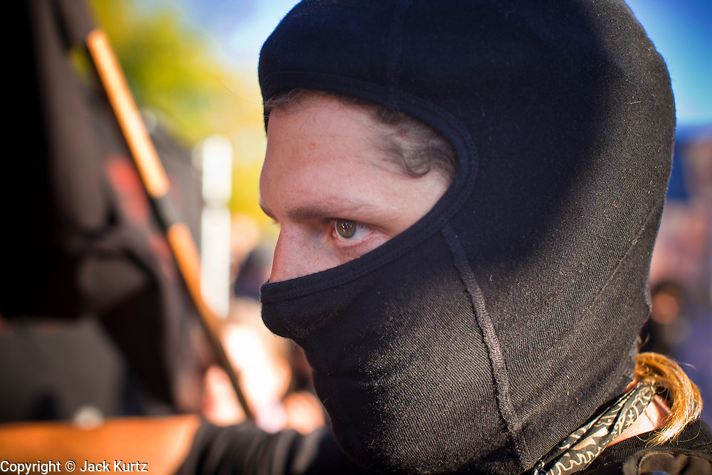 30 NOVEMBER 2011 - PHOENIX, AZ:   An anti-ALEC protester in front of the Westin Kierland Resort and Spa Wednesday. About 300 people picketed the American Legislative Exchange Council (ALEC) conference at the Westin Kierland Resort and Spa in Phoenix, AZ, Wednesday. The protesters claim ALEC, a conservative think tank, violates its tax exempt status by engaging in lobbying, a charge ALEC officials deny. Many conservative pieces of legislation, like Arizona's anti-immigration bill SB1070, originate with ALEC conferences (SB 1070 originated at an ALEC conference several years ago). Many of the protesters are also members of the Occupy movement.     PHOTO BY JACK KURTZ