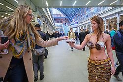 © Licensed to London News Pictures. 12/10/2015. London, UK. A model dressed in clothing made entirely from chocolate handing out chocolate to commuters whilst showcasing The Chocolate Show's fashion collection at St Pancras International station on Monday, 12 October, 2015. Photo credit: Tolga Akmen/LNP