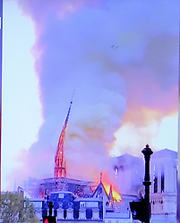 Video grabs from BFMTV of Notre Dame cathedral on fire where the main arrow dated of the 13th century is falling down in France on March 15, 2019. Video grabs by JMP/ABACAPRESS.COM