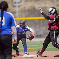 Rehoboth Lynx Gabi Barton (25) jumps to second base ahead of the tag from  Navajo Pine Warrior Mariah Yazzie (3) Thursday at Ford Canyon Park in Gallup.