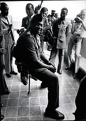 1968 - Uganda President Idi Amin Dada, rests on a shooting sick wearing a gun in the corridors of the conference hall in Libreville attending the Dau Summit hers. He told newsmen that the shooting stick was given to him by the Scots and that he is now the conqueror of the British Empire. Credit : Camerpix (Credit Image: © Keystone Pictures USA/ZUMAPRESS.com)