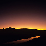 Sunset over mountain with water reflection. Morelos, Mexico.