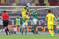 ROMANIA, Bucharest : Romania's Bogdan Stanciu (L) and a Northern Ireland's player vie for the ball during the Euro 2016 Group F qualifying football match Romania vs Northern Ireland in Bucharest, Romania on November 14, 2014.