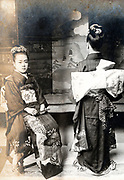 two 13 year old girls posing in studio setting Japan ca 1930s