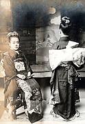 two 13 year old girls posing in studio setting Japan ca 1930s