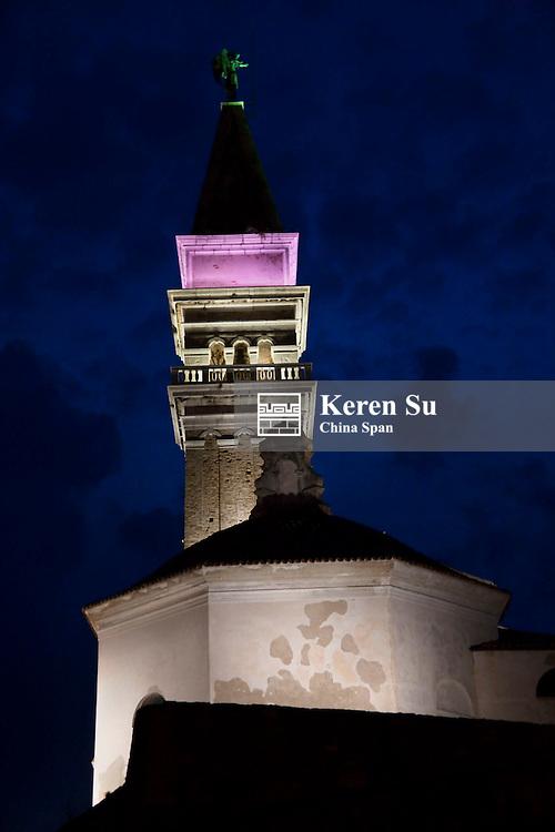 Night view of St George Church tower in Tartini Square in Piran, Slovenia