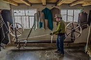 A Kichwa weaver spinning wool.