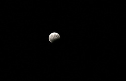 August 8, 2017 - Gaza City, Gaza Strip, Palestinian Territory - The moon goes into lunar eclipse as seen from Gaza city on August 07, 2018. The eclipse coincided with the moon being at it's closest point to earth on it's elliptical orbit  (Credit Image: © Mohammed Asad/APA Images via ZUMA Wire)