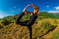 Woman doing yoga, Rim Creek Trail, above Snowmass Village (Aspen), Colorado USA.