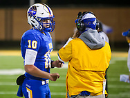 North Myrtle Beach Chiefs quarterback Cameron Freeman (10) speaks with North Myrtle Beach Chiefs head coach Matt Reel during the first half the state championship game against the AC Flora Falcons at Benedict College.