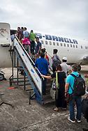 Passengers board a US-Bangla flight to Dhaka at Cox's Bazar airport in Bangladesh