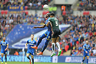 Tom Elliott of AFC Wimbledon heads the ball over Curtis Nelson of Plymouth Argyle. Skybet football league two play off final match, AFC Wimbledon v Plymouth Argyle at Wembley Stadium in London on Monday 30th May 2016.<br /> pic by John Patrick Fletcher, Andrew Orchard sports photography.