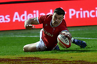 Rugby Union - 2020 Autumn Nations Cup - Group A - Wales vs England  - Parc y Scarlets<br /> <br /> Johnny Williams of Wales scores a try <br /> in a stadium without fans because of the pandemic crisis<br /> <br /> COLORSPORT/WINSTON BYNORTH
