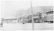 """Two RGS class 60 locomotives switching freight at Placerville with engineer Israel at the far left.<br /> RGS  Placerville, CO  Taken by Virden, Walter - ca 1910-1915<br /> In book """"Southern, The: A Narrow Gauge Odyssey"""" page 147<br /> Also in """"RGS"""", p. 58."""
