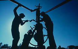 Three men working on an oil and gas work site.