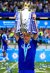 File photo dated 24-05-2015 of Chelsea's John Terry celebrates with the trophy after the Barclays Premier League match at Stamford Bridge, London.