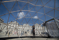© Licensed to London News Pictures. 18/04/2018. London, UK. A visitor walks through one of British artist Michael Pinsky's Pollution Pods, a new sensory work installed in the courtyard at Somerset House in London to mark Earth Day 2018. A series of five connecting domes recreate the pollution from London, Beijing, São Paulo, New Delhi and Tautra in Norway. Visitors are invited to experience first-hand the difference in the air quality of global environments. The Pollution Pods are open until 25th April 2018, including Earth Day on the 22nd April. Photo credit: Peter Macdiarmid/LNP