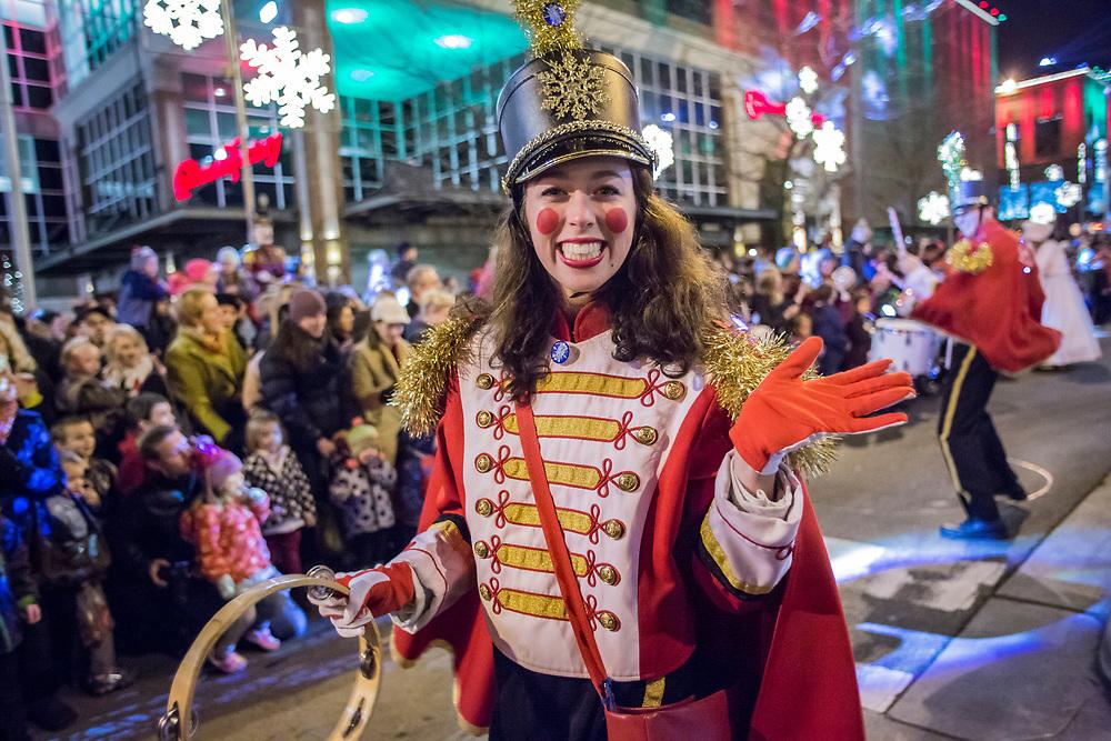 USA, Washington, Bellevue. Snowflake Lane nightly holiday performance in downtown Bellevue.