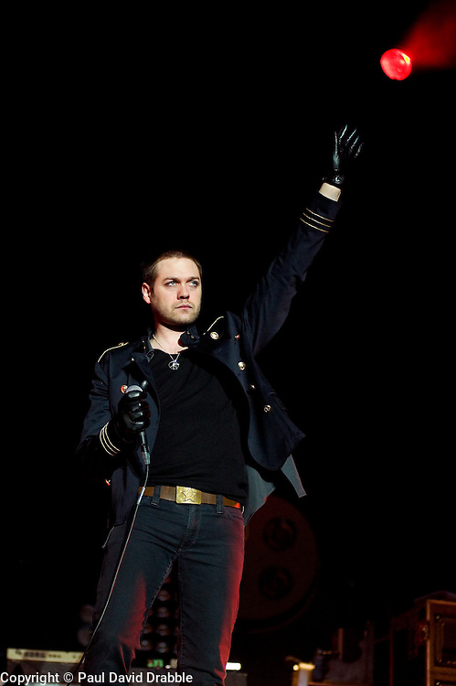 Tom Meighan Kasabian lead singer on stage at the Sheffield Arena during the West Ryder Pauper Lunatic Asylum 23 November 2009