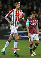 Football - 2016 / 2017 Premier League - West Ham United vs. Stoke City<br /> <br /> Peter Crouch of Stoke City towers over Mark Noble of West Ham  at The London Stadium.<br /> <br /> COLORSPORT/DANIEL BEARHAM