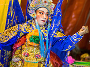16 JANUARY 2015 - BANGKOK, THAILAND:  A performer with the Sai Yong Hong Opera Troupe on stage at the Chaomae Thapthim Shrine, a Chinese shrine in a working class neighborhood of Bangkok near the Chulalongkorn University campus. The troupe's nine night performance at the shrine is an annual tradition and is the start of the Lunar New Year celebrations in the neighborhood. Lunar New Year, also called Chinese New Year, is officially February 19 this year. Teochew opera is a form of Chinese opera that is popular in Thailand and Malaysia.   PHOTO BY JACK KURTZ