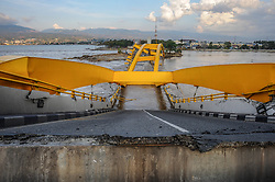 October 3, 2018 - Palu, Central Sulawesi, Indonesia - The Ponulele Bridge of Palu City which collapsed due to the earthquake and tsunami.  A deadly earthquake measuring 7.7 magnitude and the tsunami wave caused by it has destroyed the city of Palu and much of the area in Central Sulawesi. According to the officials, the death toll from devastating quake and tsunami rises to 1,347, around 800 people in hospitals are seriously injured and some 62,000 people have been displaced in 24 camps around the region. (Credit Image: © Hariandi Hafid/SOPA Images via ZUMA Wire)